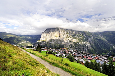 View of the traditional car-free Walser mountain village of Muerren above the Lauterbrunnen Valley and opposite of Staldenfluh Mountain, Canton of Bern, Switzerland, Europe