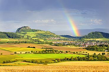 View on Mt. Hohentwiel and a rainbow, Hegau region, Landkreis Konstanz county, Baden-Wuerttemberg, Germany, Europe