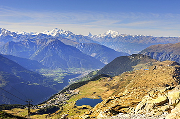 View from Bettmerhorn Mountain, 2872 metres high, down to Bettmeralp with Bettmersee lake and the Rhone Valley with the Pennine Alps on the horizon, Canton of Valais, Switzerland, Europe