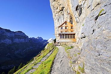 The Aescher mountain restaurant near the Wildkirchli caves below the Ebenalp cliff, Canton Appenzell Inner Rhodes, Switzerland, Europe