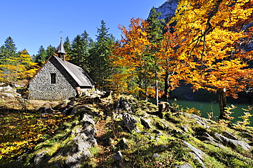 Chapel on Seealp Lake with autumnal vegetation, Canton of Appenzell Inner-Rhodes, Switzerland, Europe
