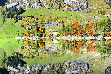 Ebenalp Mountain guest house on a penisula, reflected in Seealp Lake, at 1143 m altitude, Canton of Appenzell Inner-Rhodes, Switzerland, Europe