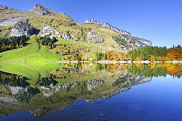 Schaefler, Fueessler, Zisler and Ebenalp mountains reflected in Seealp Lake, at 1143 m altitude, Canton of Appenzell Inner-Rhodes, Switzerland, Europe