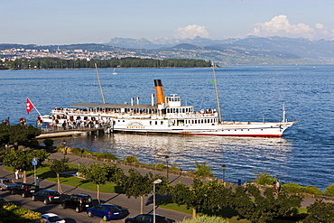 An old paddle-steamer as a ferry for tourists docked near Morges, canton of Vaud, Switzerland, Europe
