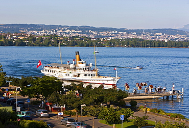 An old paddle-steamer as a ferry for tourists approaching a dock near Morges, canton of Vaud, Switzerland, Europe