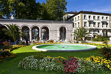 Pensioners in the Kurgarten Cafe, a cafe in a spa garden of the Kurhaus spa hotel with the Regentenbau building and arcade halls, Bad Kissingen, Lower Franconia, Bavaria, Germany, Europe