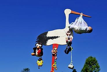 Stork showing the birth of a child, local custom, Reit im Winkl, Bavaria, Germany, Europe