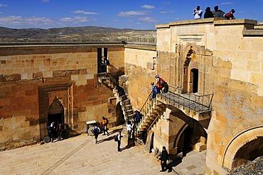 Tourists in the Sarihan caravanserai, Cappadocia, Turkey, Western Asia