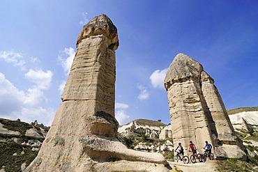 Mountain bikers in Love Valley, Guevercinlik Valley, Goereme, Cappadocia, Turkey