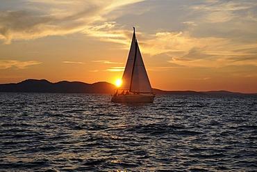 Sunset at sea, sailing ship, Zadar, Croatia, Europe
