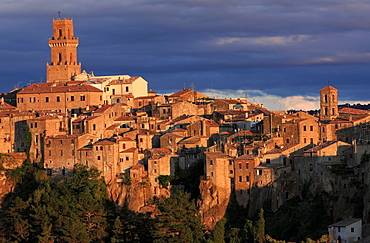 View to medieval town of Pitigliano situated on a volcanic limestone plateau with Campanile on the left, evening light, Maremma, Tuscany, Italy, Europe