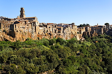 View to medieval limestone town of Pitigliano, situated on rocks raising from a green valley, Maremma, Tuscany, Italy, Europe