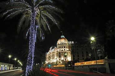 Hotel Negresco on the Promenade des Anglais at Christmas, palm tree with fairy ights, Nice, Departement Alpes Maritimes, Region Provence Alpes Cote d'Azur, Mediterranean, Europe