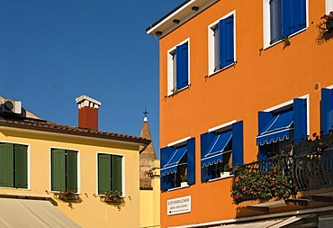 Brightly painted house facades, historic town centre of Caorle, Veneto, Italy, Europe