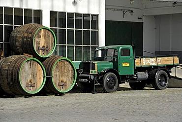 Shipping building, beer transport with historic barrels, Praga L truck from 1930, Pilsner Urquell brewery, Pilsen, Bohemia, Czech Republic, Europe
