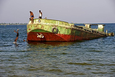 Children playing in a derelict barge on Lake Victoria, Bukoba, Tanzania, Africa