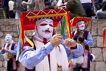 Man wearing a traditional costume at a parade in Aguas Calientes, Peru, South America