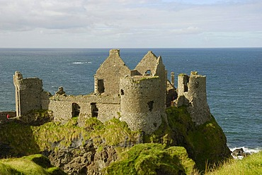 Ancient ruins Dunluce Castle on a cliff on the coast, County Antrim, Northern Ireland, United Kingdom, Europe