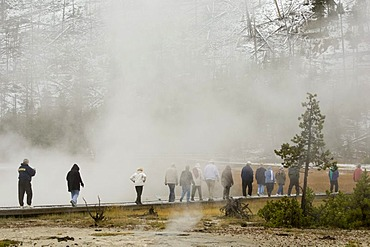 Tourists at Black Sand Basin, Yellowstone National Park, Wyoming, USA