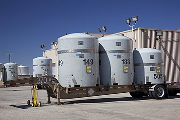 Radioactive plutonium and americium waste from America's nuclear weapons program in TRUPACT shipping containers at the Waste Isolation Pilot Plant; nuclear waste is shipped by truck from all over the country to be stored in rooms carved out of an ancient