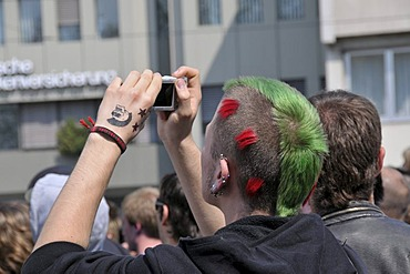 Punk taking a photograph at a NPD rally in Ulm, Baden-Wuerttemberg, Germany, Europe
