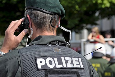 Policeman from the Evidence and Arrest Unit, BFE, using a mobile phone at a NPD rally in Ulm, Baden-Wuerttemberg, Germany, Europe