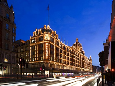 Harrods Department Store at dusk with traffic trails, Knightsbridge, London, England, United Kingdom, Europe