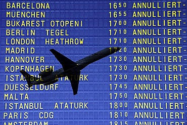 Arrival and departure board at airport, flying ban because of volcanic eruption, canceled flights