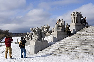 Tourists in front of sculptures in Vigeland Park, Oslo, Norway, Europe