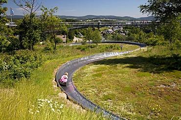 Summer toboggan run and panoramic bridge at the Erlebnisberg Kappe recreational park, Winterberg, Sauerland, North Rhine-Westphalia, Germany, Europe