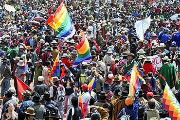 Crowd with Wiphala, rainbow-colored flag of the highland Indians, at the re-election ceremony for President Evo Morales Ayma in Tiwanaku, La Paz, Bolivia, South America