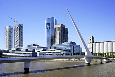 Puente de la Mujer, a modern suspension bridge, Women's Bridge and office towers in the old Puerto Madero harbor, Puerto Madero district, Buenos Aires, Argentina, South America