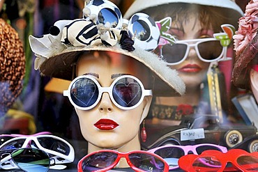 Crazy sunglasses in a shop window, Calle Defensa Street, historical district and tourist quarter of San Telmo, Buenos Aires, Argentina, South America