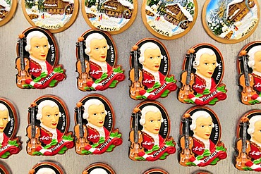 Refrigerator magnets with the image of Wolfgang Amadeus Mozart at a kiosk in the historic town centre of Salzburg, Salzburg, Austria, Europe