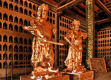 Restored statues on the construction site of the Chua Bai Dinh pagoda, one of the largest pagodas in Southeast Asia, near Ninh Binh, Vietnam, Southeast Asia