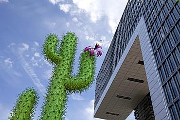 A metal cactus standing next to a Kranhaus building, Rheinau port, Cologne, North Rhine-Westphalia, Germany, Europe