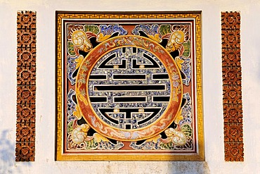 Window shaped like the Confucian symbol of luck, Hoang Thanh Royal Citadel, Hue, North Vietnam, Vietnam, Southeast Asia, Asia