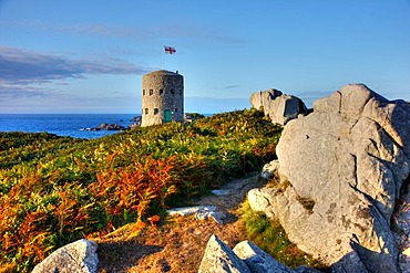 Martello towers, watch and guard towers from the 17th century found along the coastline, here Tower No. 5 at Pembroke Bay in the northeast of Guernsey, Channel Islands, Europe