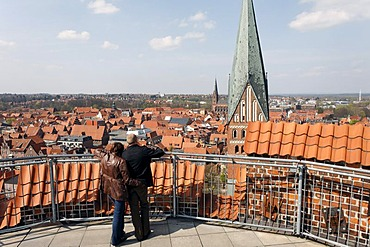 Couple looking from the terrace of the water tower on the historic old town, Lueneburg, Lower Saxony, Germany, Europe
