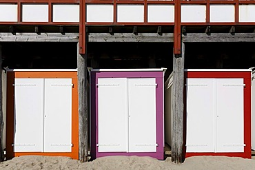 Three coloured beach huts with white doors, Westkapelle, Walcheren peninsula, Zeeland province, Netherlands, Benelux, Europe