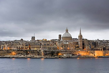 View of Sliema with St. Paul's Cathedral and Carmelite Church at dusk, Marsamxett Harbour, Valletta, Malta, Europe