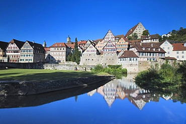 Rows of houses in the historic centre of Schwaebisch Hall, reflected in Kocher River, Hohenlohe, Baden-Wuerttemberg, Germany, Europe