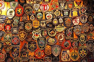 Police badges, O'Connor's Pub, Doolin, County Clare, Ireland, Europe