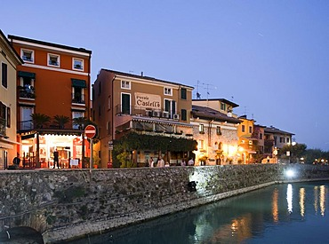 Tourists sitting in a restaurant in Sirmione village, Lombardy, Italy, Europe