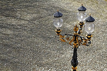 Three-armed ornate lamp on the paved palace square at Buergeln Castle, built around 1762, Schliengen, Baden-Wuerttemberg, Germany, Europe