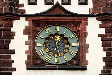 Clock on Martinstor tower, 13th century, Kaiser-Joseph-Strasse, Freiburg im Breisgau, Baden-Wuerttemberg, Germany, Europe