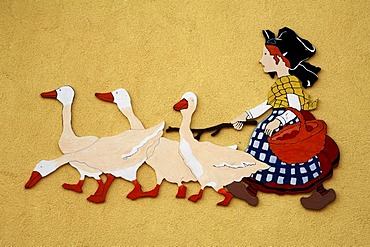 Goose Girl, girl with four geese as decoration on a building wall, 33 Grand'Rue, Ammerschwihr, Alsace, France, Europe