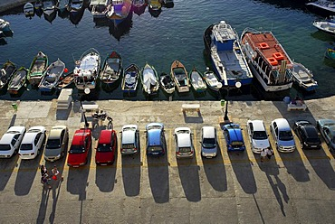 Parked cars and fishing boats in the harbour, Bay of Marsalforn, Marsalforn, Gozo Island, Malta, Mediterranean Sea, Europe