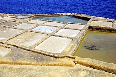 Salt works, rocky coast with salines, Xwejni Bay, Marsalforn, Gozo Island, Republic of Malta, Mediterranean Sea, Europe