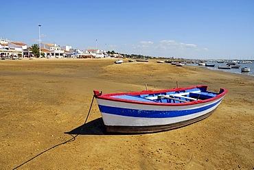 Boat at the Rio Piedras river, ebb tide at the beach in El Rompido, Cartaya, Costa de la Luz, Huelva region, Andalucia, Spain, Europe